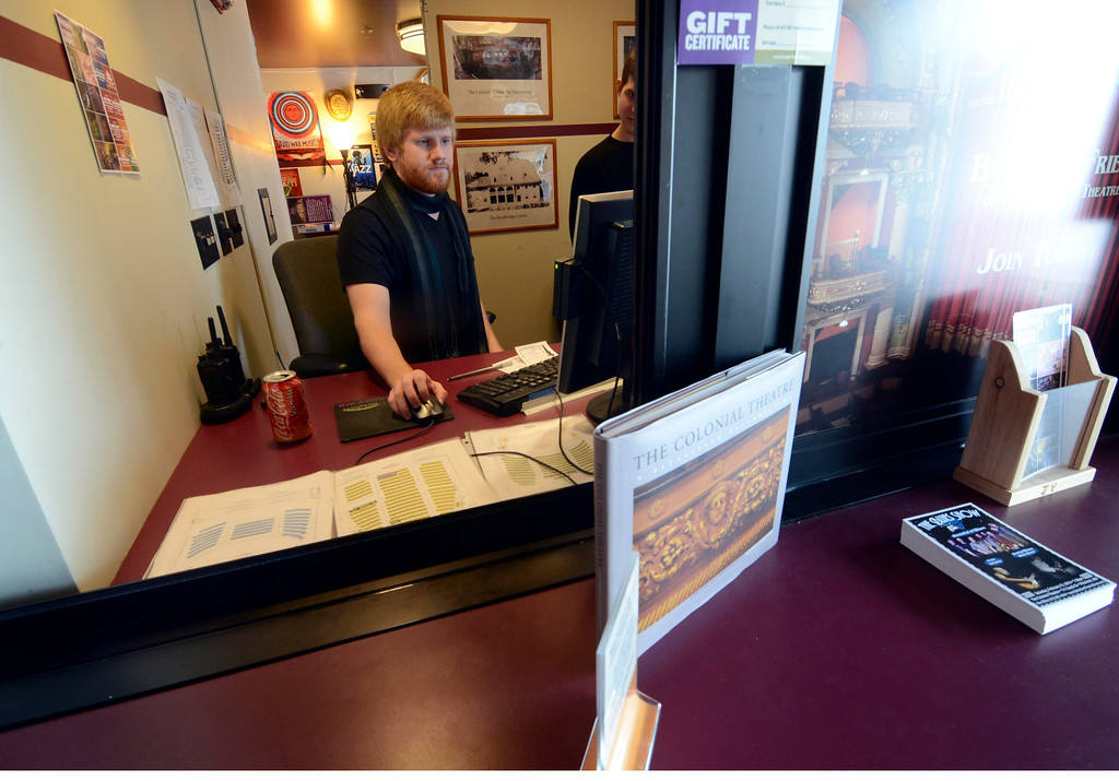 . Corey Cavenaugh works at the front desk at the Colonial Theatre, Tuesday January 21, 2014.  Photo by Ben Garver / Berkshire Eagle Staff