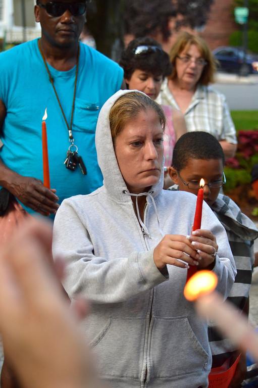 . Lisa Clayton holds a candle to honoto Trayvon Martin. At 7:17pm protesters lit candles in a vigil for Trayvon Martin in Park Square in Pittsfield, Wednesday July 17, 2013. Ben Garver / Berkshire Eagle Staff