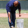 Ed Torres seeds the infield at Wahconah Park in preparation for the Colonials' home opener on Monday.  Pittsfield, 5/28/10 - Ian Grey