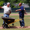 Tony Stracuzzi, City of Pittsfield superintendent of grounds maintenance, speaks with city employee, Ed Torres at Wahconah Park.  Stracuzzi and roughly 5 other city workers spent the day readying the ball field for the Colonials' home opener on Memorial Day.  Pittsfield, 5/28/10 - Ian Grey