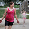 "HALEY WARD | THE GOSHEN NEWS <br /> Christine Cupp and her granddaughter Aamaya Tackett, 3, play in splash pad at Walnut Park on Thursday. ""She likes to come down here because the pool is too deep for her at the house,"" Cupp said."