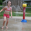 "HALEY WARD | THE GOSHEN NEWS <br /> Aamaya Tackett, 3, from Goshen runs through the splash pad on Thursday at Walnut Park. Her grandma Christine Cupp said they have a pool at home but Tackett prefers the splash pad. ""She likes to come down here and run through the water. It's more fun for her,"" Cupp said."