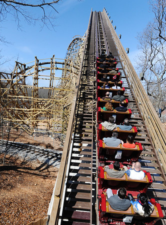 Globe/T. Rob Brown<br /> Outlaw Run starts its journey Wednesday, March 13, 2013, at Silver Dollar City in Branson. Outlaw Run is the park's new hybrid wood-steel coaster with multiple inversions including a double barrel roll.