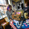 KRISTOPHER RADDER — BRATTLEBORO REFORMER<br /> Sue Pachalis weights out a box of food that was donated during the Overflow the Opera House event at the Bellows Falls Opera House, in Bellows Falls, to help out the Out Place Drop-in Center on Thursday, Sept. 12, 2019.