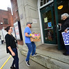 KRISTOPHER RADDER — BRATTLEBORO REFORMER<br /> Brian Joy and Chelsea Peake, from PK Irish Pub, donate a box of food during the Overflow the Opera House event at the Bellows Falls Opera House, in Bellows Falls, to help out the Out Place Drop-in Center on Thursday, Sept. 12, 2019.