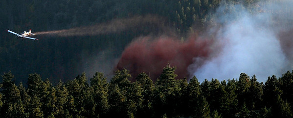 A spotter plane works over the Peewink Fire on Friday west of Boulder, Colorado on September 17, 2010.<br /> Photo by JEREMY PAPASSO