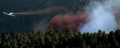 A spotter plane works over the Peewink Fire on Friday west of Boulder, Colorado on September 17, 2010. Photo by JEREMY PAPASSO