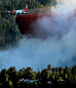 A slurry bomber drops retardant just above a checkpoint during the Peewink Fire on Friday west of Boulder, Colorado on September 17, 2010. Photo by JEREMY PAPASSO