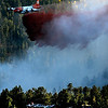 A slurry bomber drops retardant just above a checkpoint during the Peewink Fire on Friday west of Boulder, Colorado on September 17, 2010.<br /> Photo by JEREMY PAPASSO