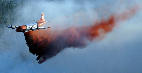 A slurry bomber drops retardant during the Peewink Fire on Friday west of Boulder, Colorado on September 17, 2010. Photo by JEREMY PAPASSO