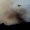 PEEWINK<br /> A slurry bomber flies over the Peewink Fire on Friday evening.<br /> Photo by Marty Caivano/Camera/Sept. 17, 2010