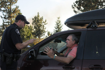 Switzerland Park resident Scott Frazier pleads with Boulder County Sheriff's Deputy Jason Shatek at a checkpoint on Sugarloaf Road during the Peewink Fire west of Boulder on Friday, Sept. 17. Frazier was trying to get into the area to evacuate an elderly woman he and his wife care for. Jeremy Papasso/ Camera