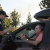 Switzerland Park resident Scott Frazier pleads with Boulder County Sheriff's Deputy Jason Shatek at a checkpoint on Sugarloaf Road during the Peewink Fire west of Boulder on Friday, Sept. 17. Frazier was trying to get into the area to evacuate an elderly woman he and his wife care for.<br /> Jeremy Papasso/ Camera