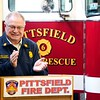 """BEN GARVER — THE BERKSHIRE EAGLE<br /> Pittsfield Fire Chief Robert Czerwinski applauds Deputy Chief Michael Polidoro during a dedication of Engine 6 """"Poly's Pride"""" in his honor. Polidoro retired two years ago due to ALS, Monday February 11, 2019."""