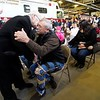 """BEN GARVER — THE BERKSHIRE EAGLE<br /> Pittsfield Fire Deputy Chief Michael Polidoro embraces Father Peter Gregory during a dedication of Engine 6 """"Poly's Pride"""" in his honor. Polidoro retired two years ago due to ALS, Monday February 11, 2019."""