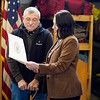 """BEN GARVER — THE BERKSHIRE EAGLE<br /> Pittsfield Mayor Linda Tyer presents Deputy Chief Michael Polidoro with a proclamation during a dedication of Engine 6 """"Poly's Pride"""" in his honor. Polidoro retired two years ago due to ALS, Monday February 11, 2019."""