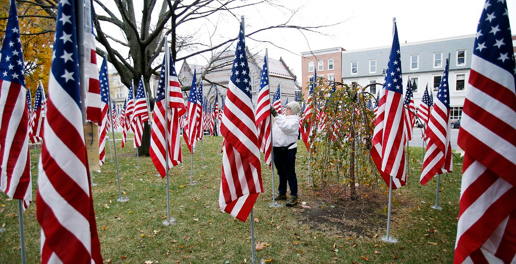 . Kathryn Mickle and other volunteers install the hundreds of flags for the annual Park of Honor event at Park Square. The flags each represent donations toward a scholarship fund for children of Berkshire County veterans and will remain on the park through the month of November. Saturday, October 29, 2016. Stephanie Zollshan � The Berkshire Eagle | photos.berkshireeagle.com