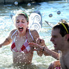 20130101_POLAR_PLUNGE_269.jpg 20130101_POLAR_PLUNGE_269.jpg Isa Wisnann-Horther reacts to the cold water during the 30th annual New Year's Day Polar Plunge at the Boulder Reservoir Tuesday Jan. 01, 2013. (Lewis Geyer/Times-Call)