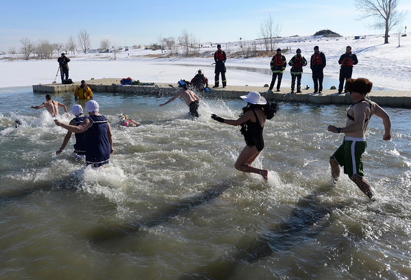20130101_POLAR_PLUNGE_719.jpg Participants run into the water during the 30th annual New Year's Day Polar Plunge at the Boulder Reservoir Tuesday Jan. 01, 2013. (Lewis Geyer/Times-Call)