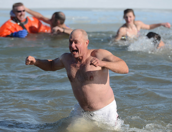 20130101_POLAR_PLUNGE_198.jpg Dale Haas, of Louisville, runs out of the frigid water during the 30th annual New Year's Day Polar Plunge at the Boulder Reservoir Tuesday Jan. 01, 2013. (Lewis Geyer/Times-Call)