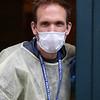 Jason Bird, director of facilities at Lowell Community Health Center, wearing personal protective equipment. (SUN/Julia Malakie)