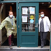 Jason Bird, director of facilities, and Esther Nganga, Associate Director of Nursing, Adult Medicine at Lowell Community Health Center, wearing personal protective equipment. (SUN/Julia Malakie)