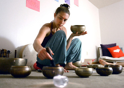 Rain Prayer002.JPG Instructor Sraddha Pavia uses Tibetan Singing Bowls during a rain prayer at Om Time on Wednesday, June 27, at 2035 Broadway in Boulder. For a video of the rain prayer go to www.dailycamera.com Jeremy Papasso/ Camera
