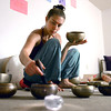 "Rain Prayer002.JPG Instructor Sraddha Pavia uses Tibetan Singing Bowls during a rain prayer at Om Time on Wednesday, June 27, at 2035 Broadway in Boulder. For a video of the rain prayer go to  <a href=""http://www.dailycamera.com"">http://www.dailycamera.com</a><br /> Jeremy Papasso/ Camera"