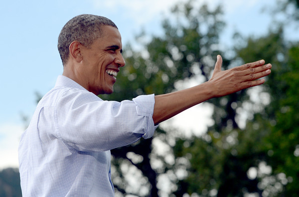 "President Barack Obama acknowledges the crowd behind him at the University of Colorado's Norlin Quad on Sunday  September 2, 2012.<br /> For more photos and a video of Obama, go to  <a href=""http://www.dailycamera.com"">http://www.dailycamera.com</a>.<br /> Cliff Grassmick  / September 2, 2012"
