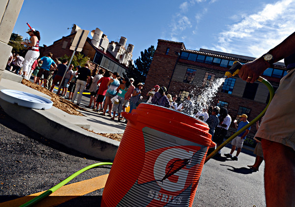 "Volunteer Marc Lee fills a water bucket as people wait in line to hear President Barack Obama speak on Norlin Quad at the University of Colorado in Boulder on Sunday, Sept. 2, 2012.  For more photos and videos visit  <a href=""http://www.DailyCamera.com"">http://www.DailyCamera.com</a>.<br /> (Greg Lindstrom/Times-Call)"