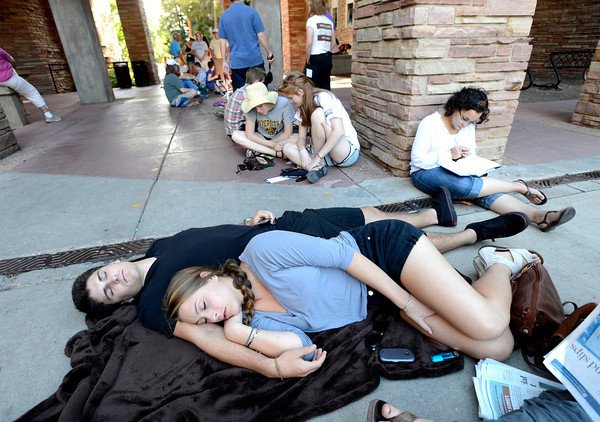 University of Colorado students Joey Miller and Julia Hirsch sleep in line on the CU Boulder Campus as the crowds wait for the appearance of President Barak Obama.<br /> Photo by Paul Aiken / The Daily Camera / September 2, 21012
