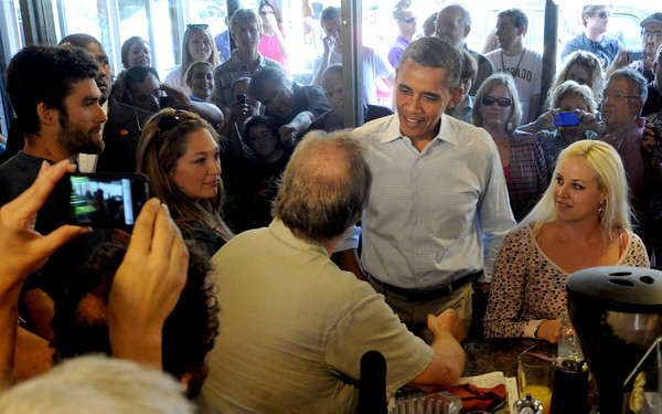 """President Barack Obama greets customers at the Buff Restaurant in Boulder on Sunday  September 2, 2012.<br /> For more photos and a video of Obama, go to  <a href=""""http://www.dailycamera.com"""">http://www.dailycamera.com</a>.<br /> Cliff Grassmick  / September 2, 2012"""
