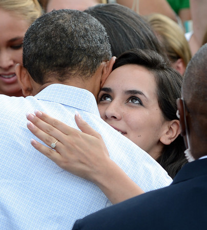 "President Barack Obama hugs a member of the audience after his speech at the University of Colorado's Norlin Quad on Sunday  September 2, 2012.<br /> For more photos and a video of Obama, go to  <a href=""http://www.dailycamera.com"">http://www.dailycamera.com</a>.<br /> Cliff Grassmick  / September 2, 2012"
