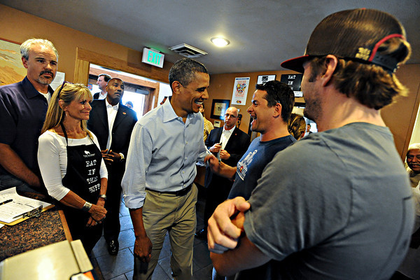 """President Barack Obama greets patrons at The Buff Restaurant before a rally on Norlin Quad at the University of Colorado in Boulder on Sunday, Sept. 2, 2012.  For more photos and videos visit  <a href=""""http://www.DailyCamera.com"""">http://www.DailyCamera.com</a>.<br /> (Cliff Grassmick/Daily Camera)"""
