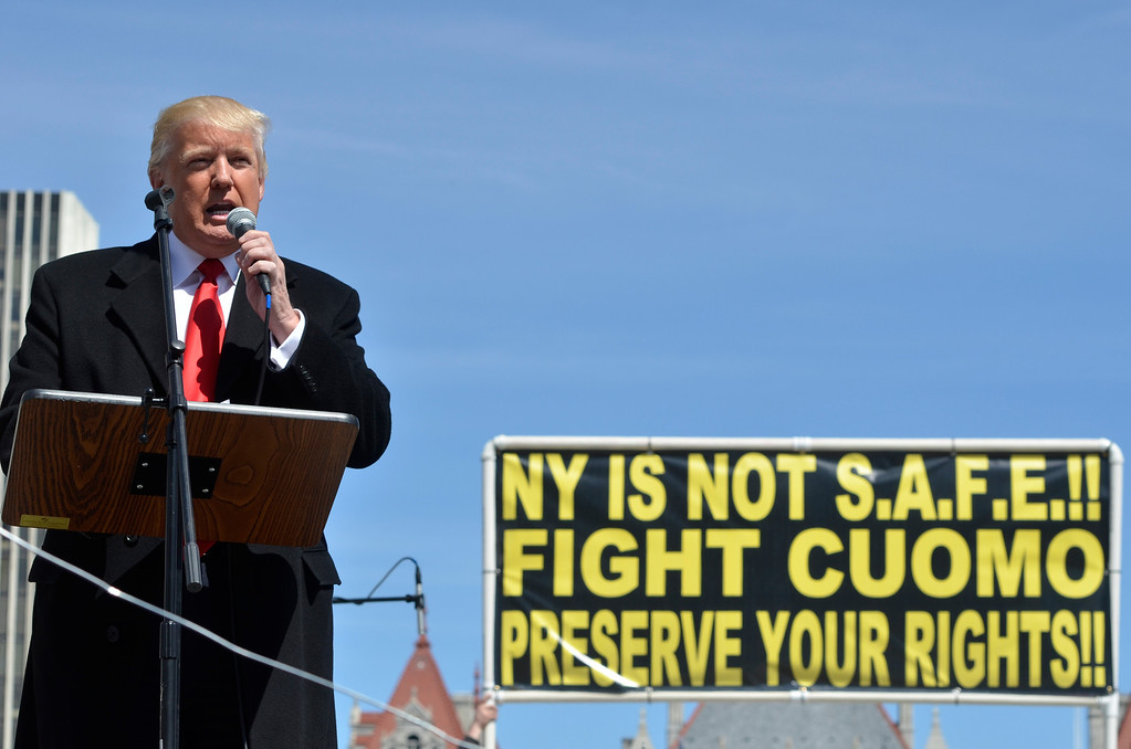 . J.S.CARRAS/THE RECORD Donald Trump, left, and Carl Paladino, who ran for governor of New York as a Republican in 2010, speak during a gun rights rally at the Empire State Plaza. Activists are seeking a repeal of a 2013 state law that outlawed the sales of some popular guns like the AR-15. The law championed by Gov. Andrew Cuomo has been criticized as unconstitutional by some gun rights activists Tuesday, April 1, 2014 in Albany, N.Y..