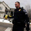 "Spot News.JPG Lafayette Police Corporal Hill puts up police tape at near 337 Lodgewood Point in Lafayette on Saturday, Jan 7. The police were responding to a report of an explosion inside a car. Two people were injured and taken to the hospital in the blast. For a video of the crime scene go to  <a href=""http://www.dailycamera.com"">http://www.dailycamera.com</a><br /> Jeremy Papasso/ Camera"