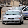 Spot News 02.JPG A Lafayette Police Officer stands near the car that allegedly had an explosion inside it burning a woman near 337 Lodgewood Point in Lafayette on Saturday, Jan 7. <br /> Jeremy Papasso/ Camera