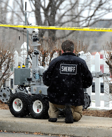 Car Explosion004.JPG A Sheriff works on a bomb robot  near 337 Lodgewood Point in Lafayette on Saturday, Jan 7.<br /> Jeremy Papasso/ Camera
