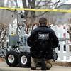 Car Explosion004.JPG A Sheriff works on a bomb robot  near 337 Lodgewood Point in Lafayette on Saturday, Jan 7.<br /> Jeremy Papasso/ Camera