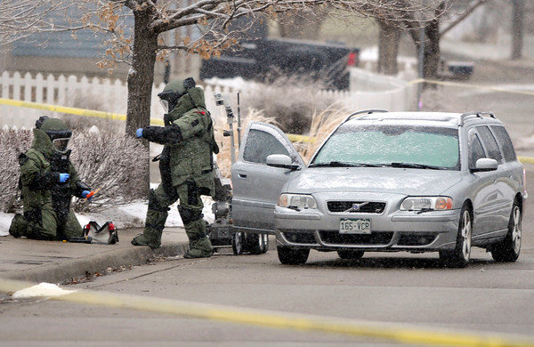 """Car Explosion005.JPG The Boulder County Bomb Squad responds to an explosion inside a car on Saturday, Jan. 7, near 337 Lodgewood Point in Lafayette. Two people inside the car were injured and taken to the hospital from the explosion. For a video of the crime scene go to  <a href=""""http://www.dailycamera.com"""">http://www.dailycamera.com</a><br /> Jeremy Papasso/ Camera"""