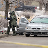 "Car Explosion005.JPG The Boulder County Bomb Squad responds to an explosion inside a car on Saturday, Jan. 7, near 337 Lodgewood Point in Lafayette. Two people inside the car were injured and taken to the hospital from the explosion. For a video of the crime scene go to  <a href=""http://www.dailycamera.com"">http://www.dailycamera.com</a><br /> Jeremy Papasso/ Camera"