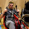 Paralympics experience 05.JPG Martin Dawson sits on a racing bike for for the first time at the Paralympic Experience at Colorado University recreation center, Feb. 11, 201, Boulder.  <br /> <br /> Photo by Derek Broussard