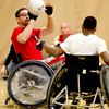 Paralympics experience 06.JPG Dean furness, left, passes the ball passed Qwalon Tabb-Tandy, right, during a game of Quad Rugby at the Paralympic Experience at Colorado University recreation Center, Feb. 11, 2012. The event was hosted by the City of Boulder. <br /> <br /> Photo by Derek Broussard