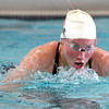Paralympics experience 03.JPG Ryan McLean demonstrates swimming styles at the Paralympic Experience at Colorado University recreation Center, Feb. 11, 2012. Ryan said that she was a swimmer even before she lost the use of her legs and now competes when ever she can. <br /> <br /> Photo by Derek Broussard