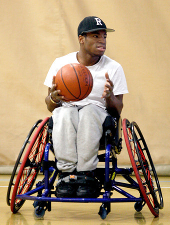 Paralympics experience 02.JPG  Qwalon Tabb-Tandy sits in a wheelchair made for playing basketball for the first time at the Paralympic Experience, Feb. 11, 2012, Boulder. The city of Boulder hosted the event at Colorado University recreation Center.<br /> <br /> Photo by Derek Broussard