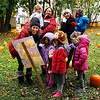 Holly Pelczynski - Bennington Banner Kim Post, a voulenteer and parent from The Village School of North Bennington reads a Halloween tale to Pre-K students before they pick pumpkins in the patch she created for all students to have a pumpkin of their very own.