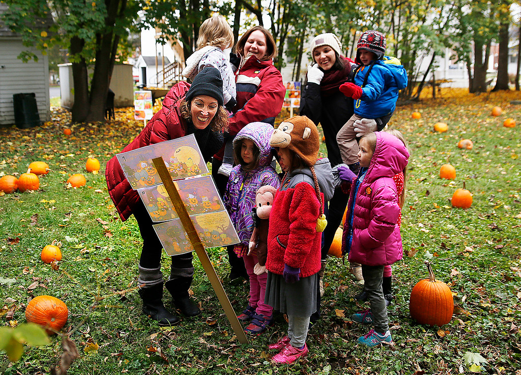 . Holly Pelczynski - Bennington Banner Kim Post, a voulenteer and parent from The Village School of North Bennington reads a Halloween tale to Pre-K students before they pick pumpkins in the patch she created for all students to have a pumpkin of their very own.