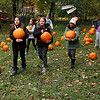 Fourth graders at the Village School of North Bennington take their pumpkins.