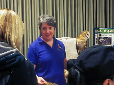 NIKKI RHOADES / GAZETTE Kate McNeece, a Medina Raptor Center volunteer, introduced Earth Day visitors to Jackie, a 9-year-old barn owl, during a program Saturday held at Buffalo Creek Retreat in Seville.