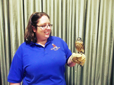 NIKKI RHOADES / GAZETTE Medina Raptor Center volunteer Jillian Raber showed Mika the American Kestrel to crowds at the Earth Day celebration that attracted hundreds of visitors on Saturdady to Buffalo Creek Retreat in Seville.